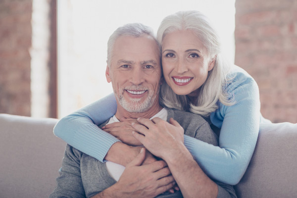 Portrait of happily married mature couple hugging at Gwinnett Dental Implant & Periodontal Center in Lilburn, GA